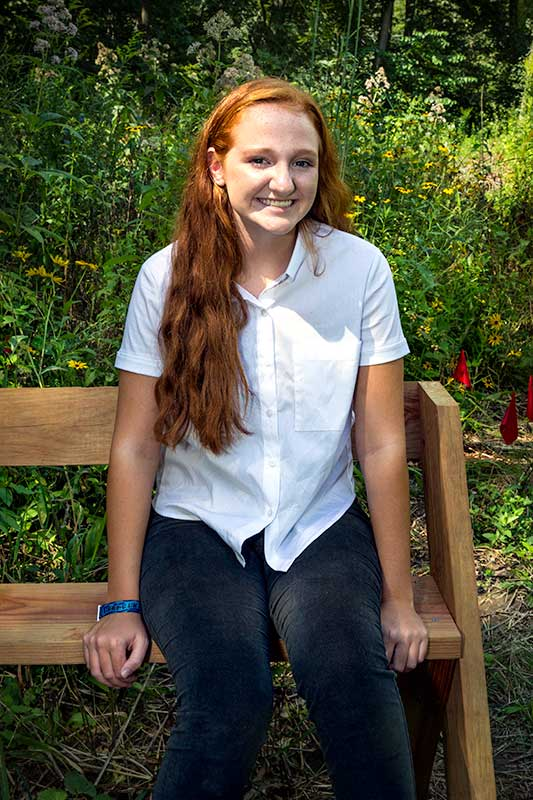 Girl Scout Erin McDermott in the butterfly garden she has created at Reed Turner.