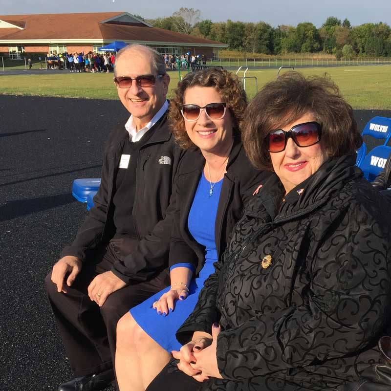 At the ribbon cutting for the new running tract at Woodlawn School (L to R) Lake County Board Representative Sidney Mathias, Me, Buffalo Grove President Beverly Sussman.