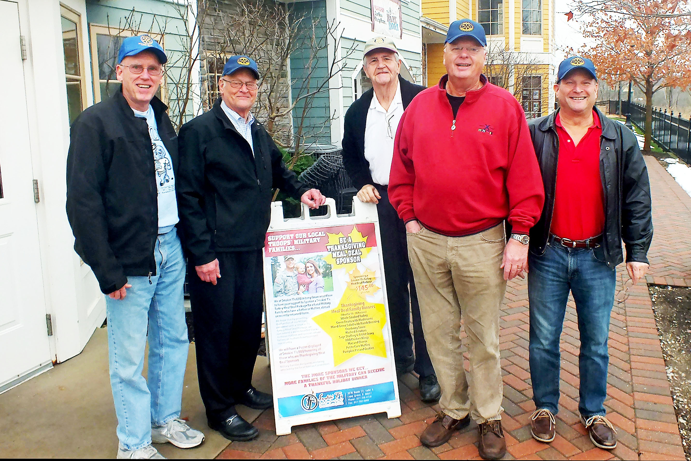 Rotarians (L to R) Ross Spencer, Jim Runnfeldt, George Dorner, Karl Riehn, and Robert Mintz prepare to deliver Thanksgiving meals to area Veterans.