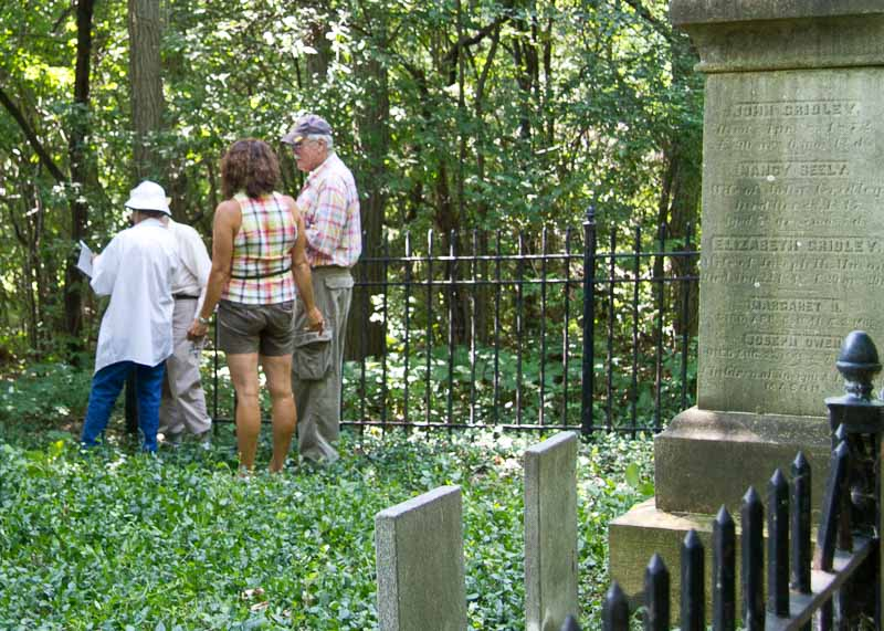 Braving weeds and hungry mosquitoes, Historical Society members made a trip to the hidden Gridley Pioneer Cemetary in July of 2010.