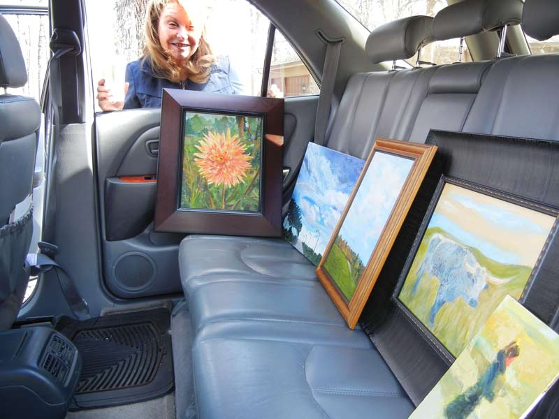 "Long Grove resident Barbara English showcases her paintings in her ""Back Seat Gallery,"" the original inspiration for the event."