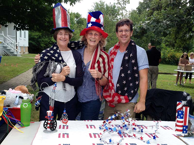Long Grove Historical Society members (L to R) Gerri Campbell, Diane Trickey, and Aaron Underwood wearing the stars and stripes and reminding us to do our patriotic duty today by voting!