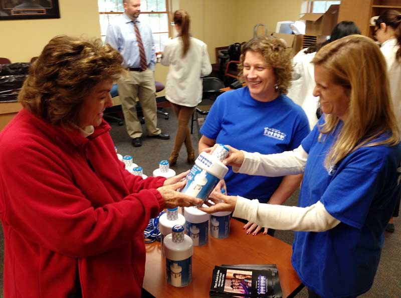 Resident Marie Borg (left) receives a free prescription drug lock box from Stand Strong Coalition Coordinator Jamie Epstein (right) at the October 22nd Drug Take Back Day.