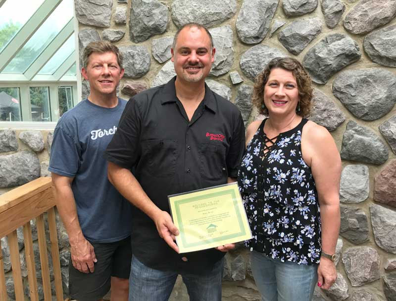 L to R: Dale Perrin, Director of the Lake Zurich Area Chamber of Commerce, Mike Marr, owner of Buffalo Creek Brewing, and Angie Underwood, President of the Long Grove Historical Society.