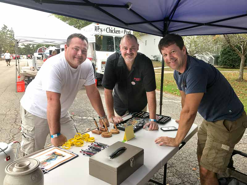 Downtown supporters (L to R) Ryan Messner, Mike Marr, and Aaron Underwood conpare notes at the Craft Beer Day on October 7th.