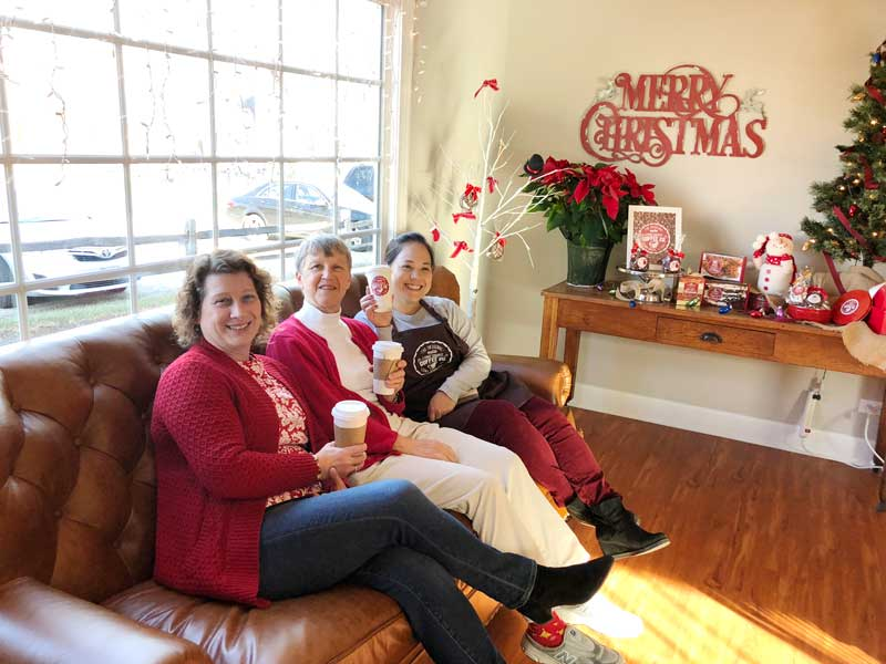 Testing out the brand new couch on December 8th (L to R): Angie Underwood, Marie Roth, and Ethel Berger.