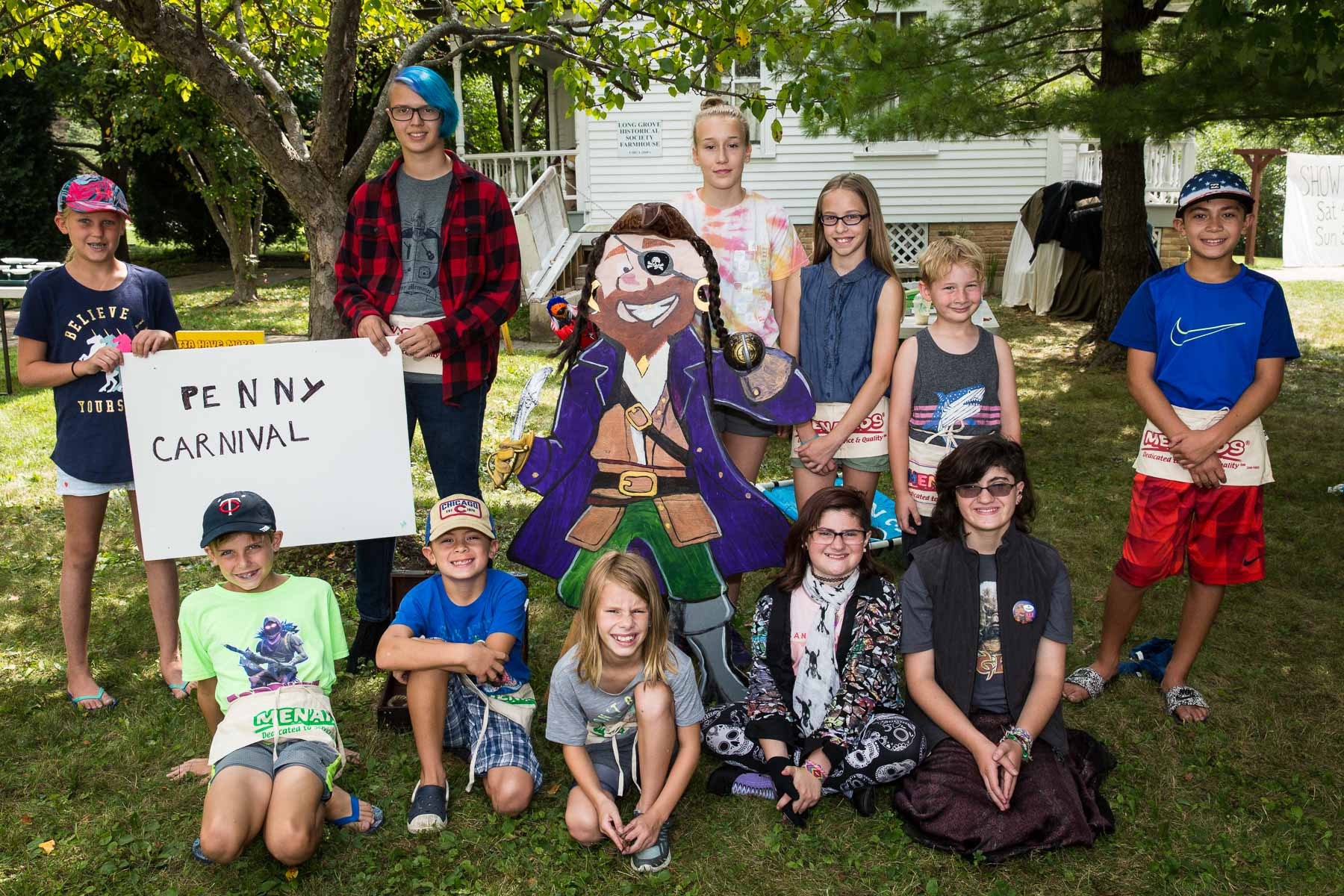 Pictured above are the awesome local kids who volunteered to help run the games for the younger kids at the Historical Society Penny Carnival.