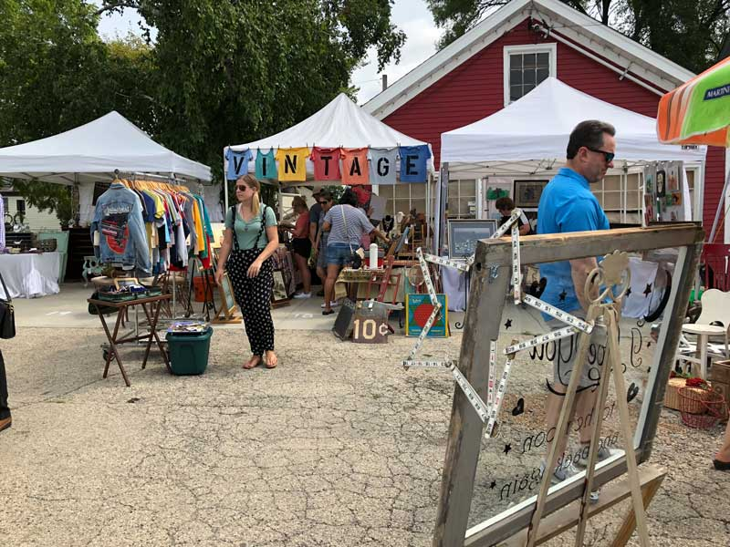 Some of the many booths in the open air market at Vintage Days.