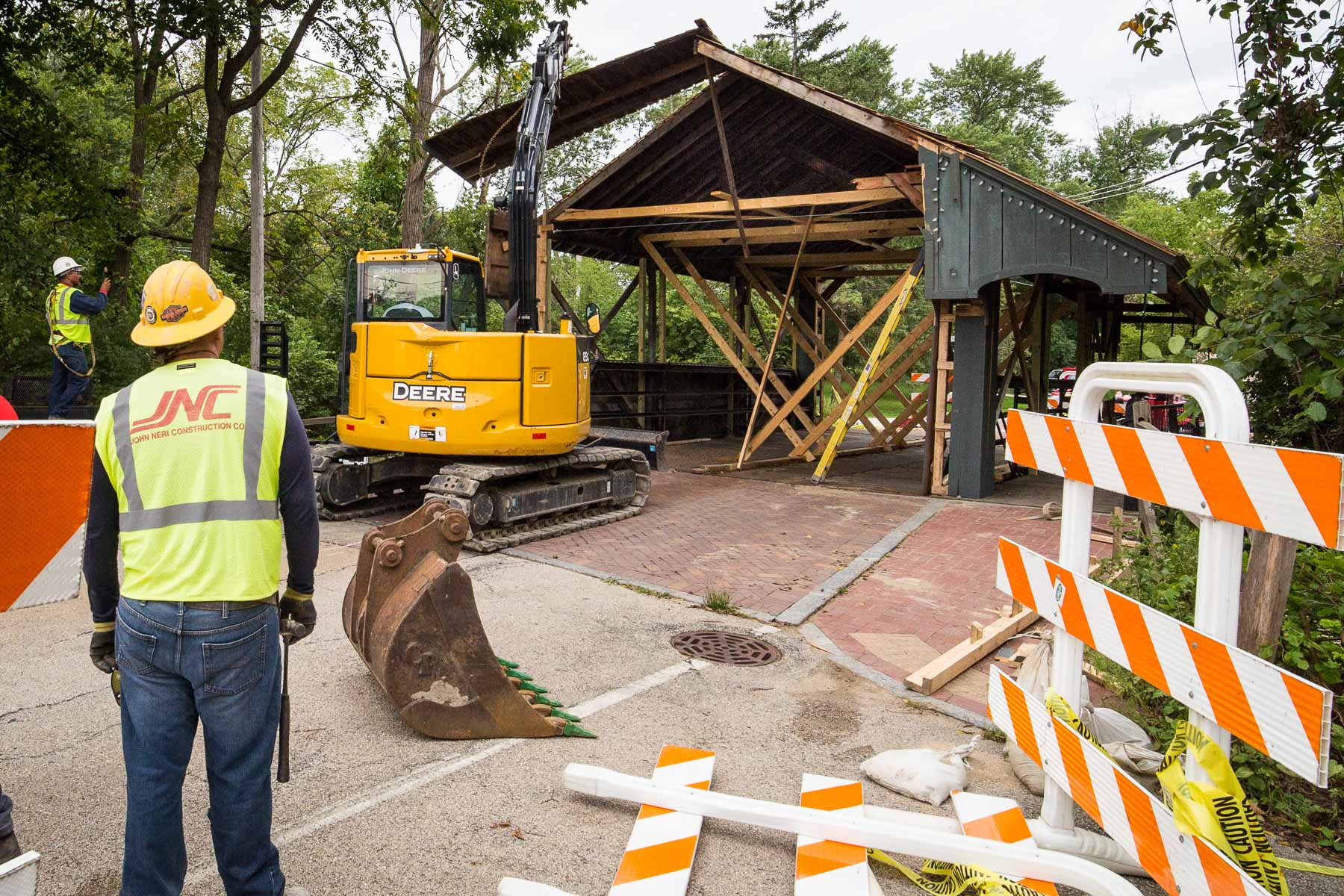 The demolition crew started bright and early this morning on removal of the damaged wooden canopy of the Long Grove bridge.