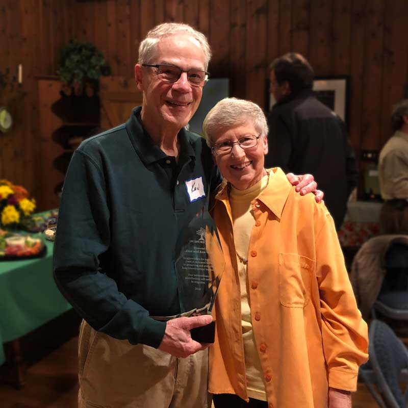 Jane and Ken Wittig are shown here on October 22, 2018 at Reed Turner Nature Center with the award they were given for 20-plus years of volunteer service to the Long Grove community.