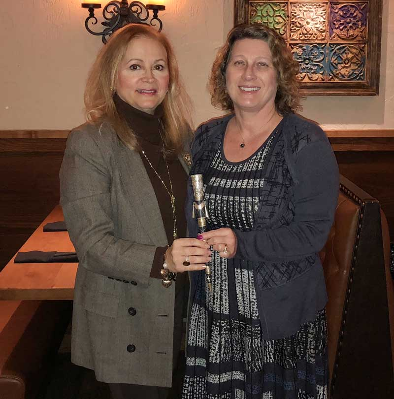 Village President of Kildeer, Nandia Black (on the left) and former Village President of Long Grove Angie Underwood on October 24, 2018, holding a Mayor Stick from Peru.