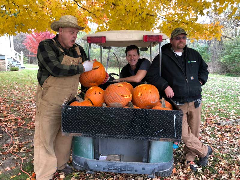 "John Kopecky, Aaron Underwood and Jessie Visocnik (L to R) work to set the scene for ""A Scary Night at the Farmhouse."""