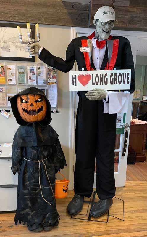 A cute and scary trick-or-treater is greeted at the Long Grove Visitor's Center by our official Halloween host, Mortimer Coffin.