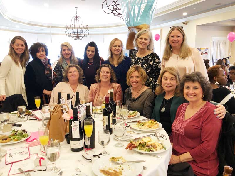 A table full of powerful and philanthropic women from Long Grove, Kildeer and Buffalo Grove  helped raise funds recently for early childhood literacy in Lake County.