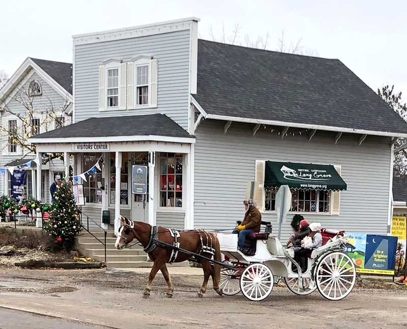 Horse-drawn carriage rides are a special treat on weekends this holiday season in Long Grove.