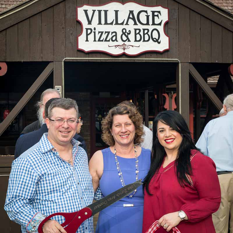 At the ribbon cutting ceremony on April 18th with new owners Rusty Gault (left) and Joanie Shunia-Gault (right).
