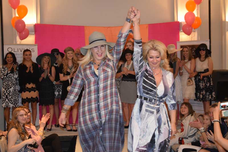 Boutique owners (L to R) Mira Pinscher of Bella Donna and Lynne Jankovec of Olivia's Past walk the runway to celebrate the conclusion of another successful fashion show.