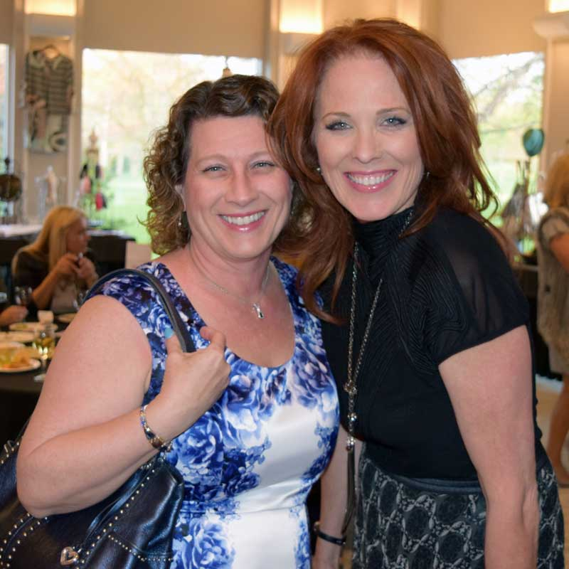 Sharing a light-hearted moment with emcee Bonnie Conte of Avalon Salon in Deerpark, at the May 5th Long Grove Fashion Show at the Grove Country Club.