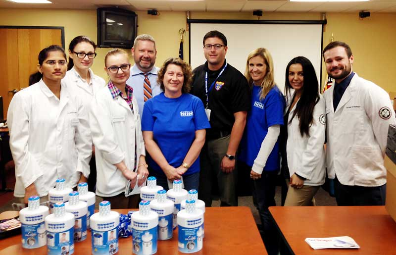 Volunteering at the Event:  Detective David Tomasello of the Lake County Sheriff's Office (3rd from right), Stand Strong members Angie Underwood and Jamie Epstein (in blue), and pharmacy students from Rosalind Franklin University.