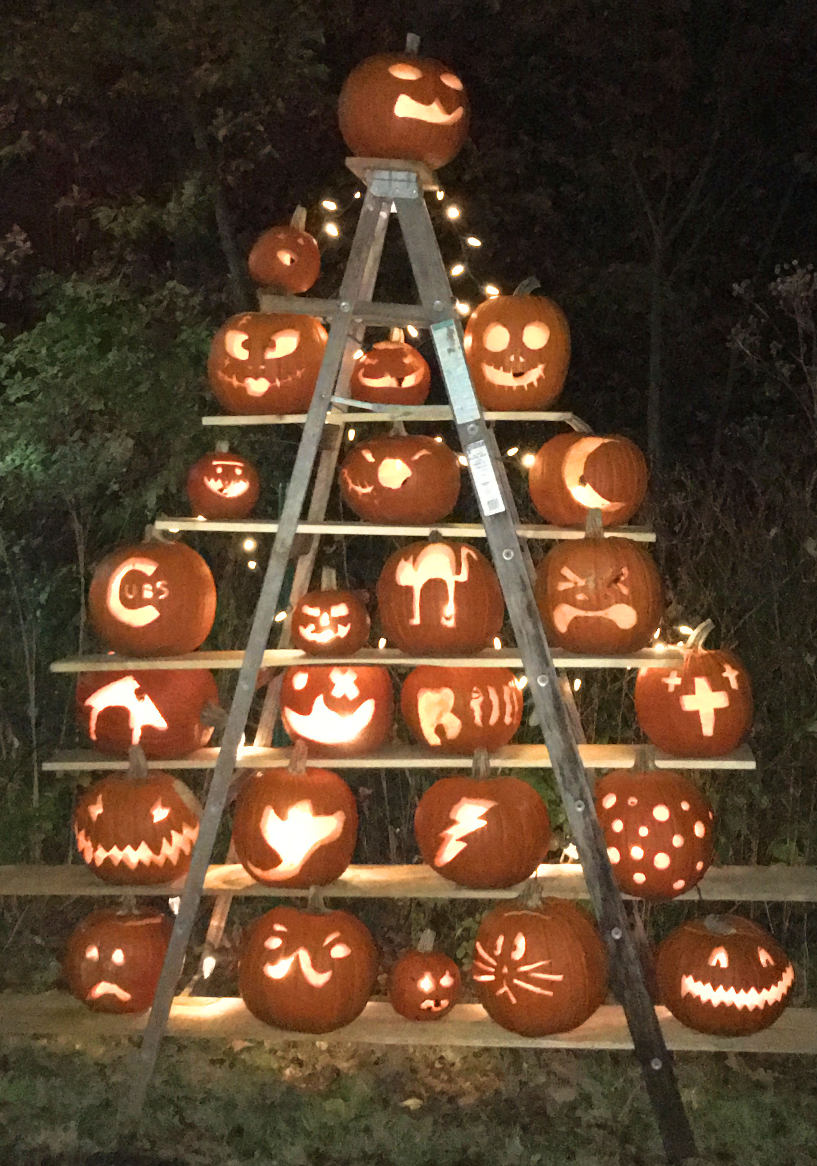 Long Grove merchants and residents worked together to create this display of hand-carved jack-o-lanterns welcoming those brave enough to experience Red Riding Hood's haunted trail.