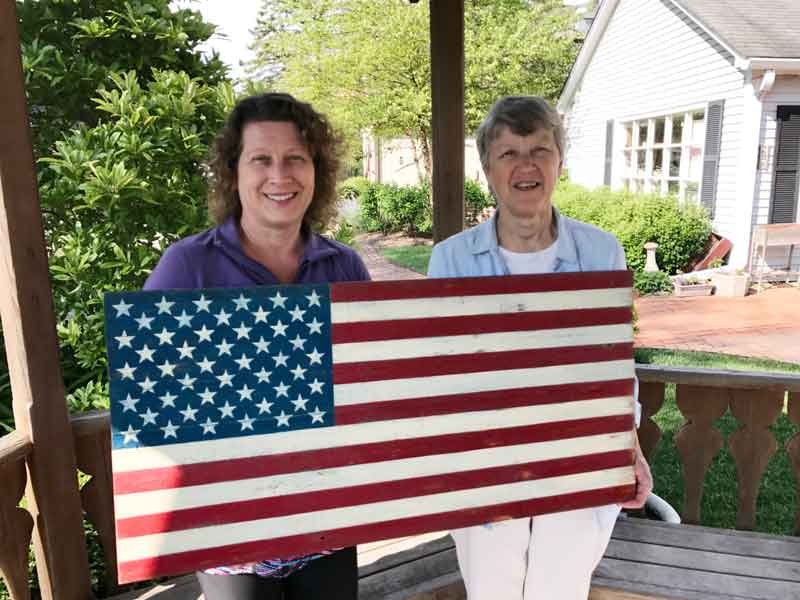 Posing with Long Grove artist Marie Roth and the patriotic gift that she created for me.