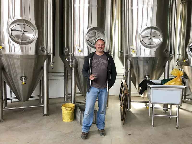 Owner Mike Marr of Buffalo Creek Brewing in front of his newly installed fermentation tanks.
