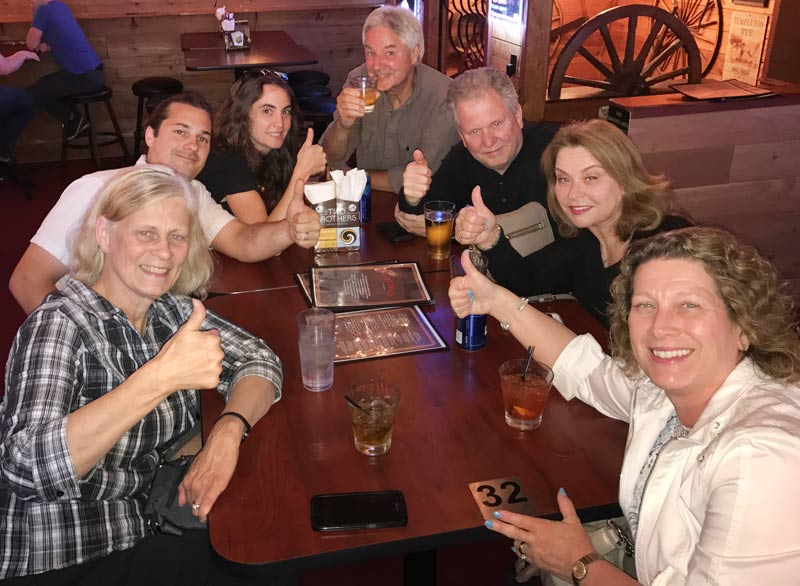Members of the Long Grove Historical Society giving thumbs-up to the good news!