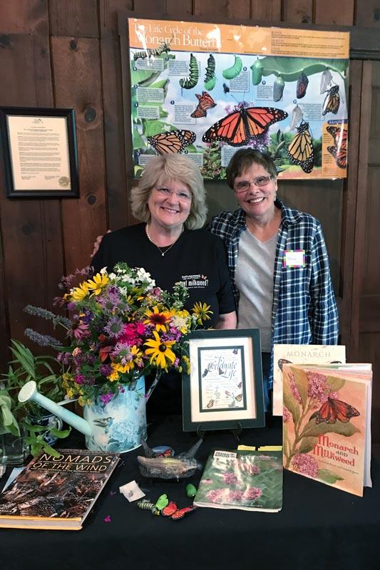 Long Grove-Kildeer Garden Club Members Paula Van Singel (L) and Kathy Michas serve as foster mothers to Monarch caterpillars in an effort to boost their dwindling numbers.