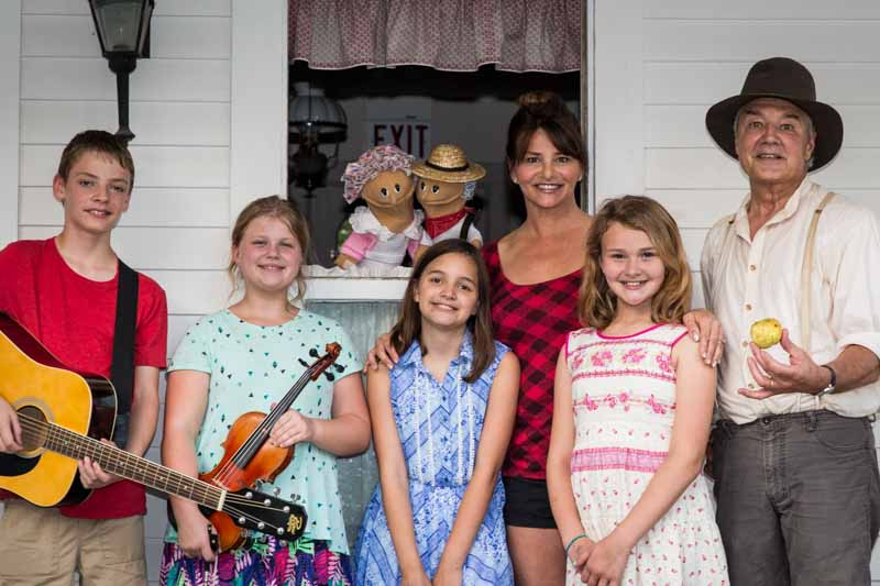 """Cast Members of the Long Grove Historical Society's """"A Celebration of the Apple"""" show include (L to R): Zack Langhoff, Veronica Lada, Nikki Gayton, Karen and Katie Kroll, Mike Dvorak, and puppeteer Krist Neumann, portraying Ma and Pa Gridley."""