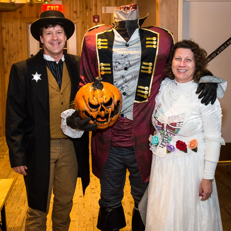The Headless Horseman (Greg Abshire) joins Aaron and Angie Underwood at the Ghost Walk after-party on October 27th.