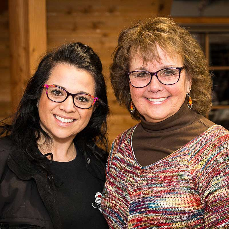 Long Grove entrepreneur Joanie Shunia (on the left) is pictured here with the original Gloria Jean.