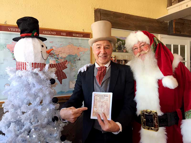 Historical Society Yuletide Sing Songmaster Mike Dvorak was seen recently recruiting Santa to the event.