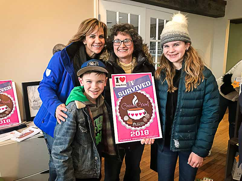 Long Grove residents (L to R): Miles Tyer, Kristen Wojicik, Pam Pasminski, and Katie Tyer are all smiles after completing the Cocoa Crawl held in downtown Long Grove on February 3rd.