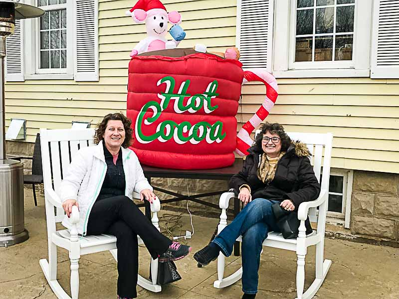 """Taking a break from our crawling, Pam and I enjoyed a short rest under the """"chocolate hot tub"""" outside of the Long Grove Coffee Company."""