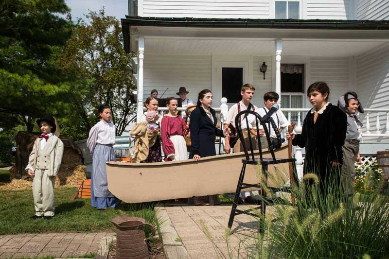 """Local kids also showcased their talent by performing an original play about our town's history entitled, """"Good Times with the Gridleys."""" The cast is shown here crossing """"Fifteen Miles on the Erie Canal."""""""