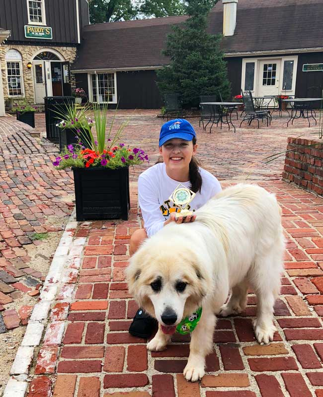 """Long Grove resident Gracie Mower shows her award-winning pooch, """"Willie"""" who captured the title of King in the dog beauty contest at Irish Days this weekend."""