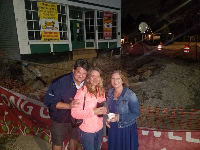 Long Grove residents Dave and Amy Gayton (on the left) join me in checking out the giant excavation at the crossroads in Long Grove during Apple Fest 2018.