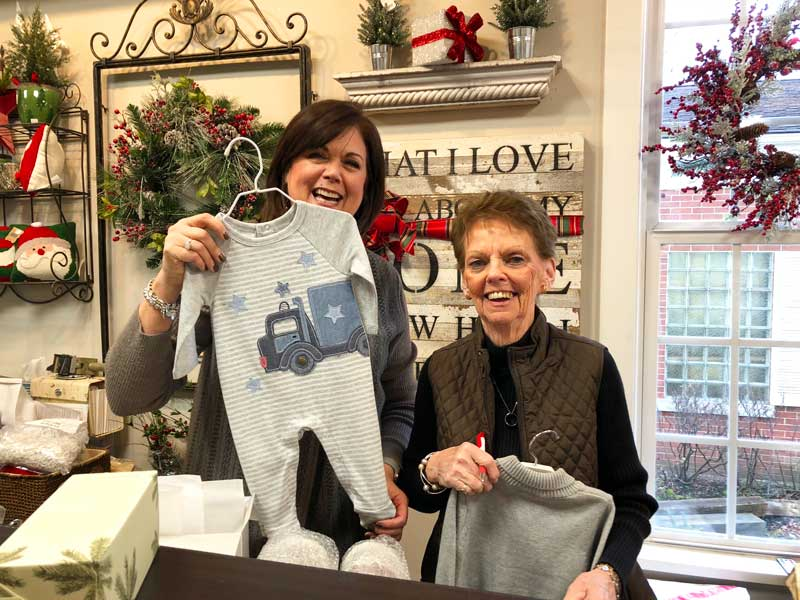 Marian, at Within Reach (on the left), who helped me select something adorable for my newborn grandson!