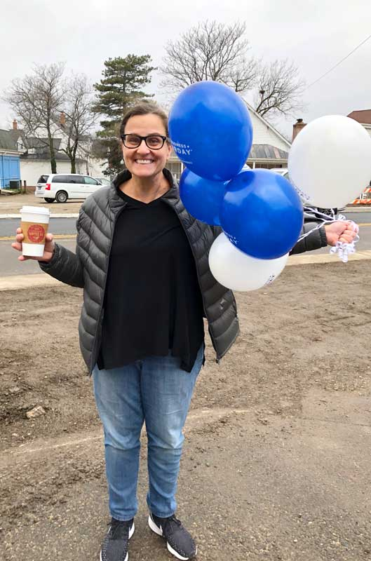 Mary, at the Long Grove Coffee Company, caught in a random act of kindness delivering Small Business Saturday balloons and a hot beverage to a fellow merchant.